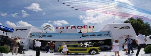 Red Arrows over Citroen stand at Goodwood Festival of speed 2014