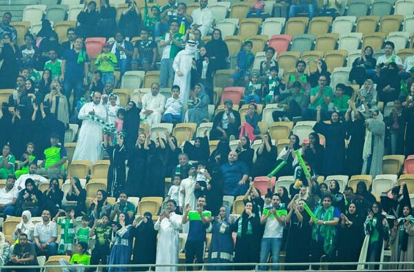 Football fans in KSA: Saudi Women cheering on the sidelines